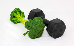 Dumbbell made of Broccoli on white background. Focus in front. Royalty Free Stock Image