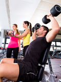 Dumbbell man at gym workout fitness weightlifting Stock Images