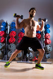 Dumbbell man workout fitness at gym Stock Photography