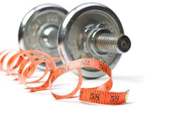 Dumbbell and measuring tape Stock Photo