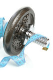 Dumbbell with measuring tape Stock Images