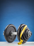 Dumbbell and Measuring Tape Royalty Free Stock Images