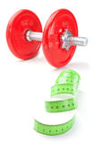 Dumbbell and meter to measure. Royalty Free Stock Images