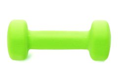 Dumbbell. One green dumbbell isolated on white background Royalty Free Stock Images