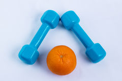 Dumbbell and orange white background sport Stock Images