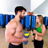 Dumbbell personal trainer man and woman talking Royalty Free Stock Images