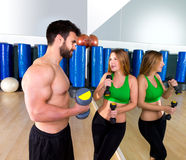 Dumbbell personal trainer man and woman talking Stock Photography