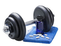 Dumbbell and pills Royalty Free Stock Photography
