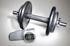 Dumbbell and pressure measuring device Royalty Free Stock Images