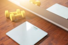 Dumbbell and scale, fat burn and weight loss stock images