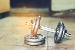 Dumbbell set. Iron Dumbbell on the floor with adjust iron weight plate Royalty Free Stock Photo