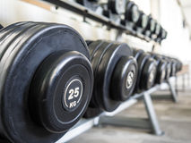Dumbbell set left on the racks. stock photography