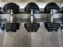 Dumbbell set left on the racks. royalty free stock photos