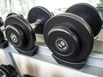 Dumbbell set left on the racks. royalty free stock photo