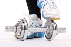 Dumbbell and shoes Stock Photography