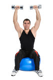 Dumbbell Shoulder Press on stability ball Stock Image