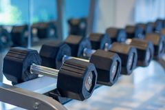 Dumbbell for sport fitness center. Row of Black dumbbell set. Close up many dumbbells in sport fitness center. Equipment in Sports club royalty free stock images