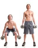 Dumbbell Squat Exercise. Studio shot over white stock photo