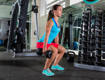 Dumbbell squat woman workout at gym Stock Photography