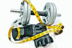 Dumbbell and tape Royalty Free Stock Images