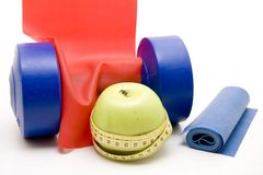 Dumbbell with tape measure Royalty Free Stock Image