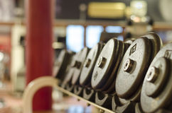 Dumbbell in their rack Stock Photos