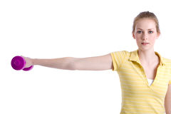 Dumbbell training. Pretty young blond girl training her arms and shoulders with a dumbbell Stock Photo