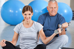 Dumbbell training in gym Royalty Free Stock Images