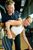 Dumbbell training with Trainer Stock Image