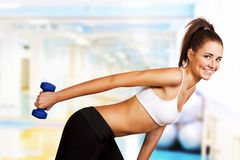 Dumbbell tricep curl by a fitness girl Stock Photo