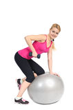 Dumbbell Triceps Extension on Fitneыs Ball Royalty Free Stock Photography