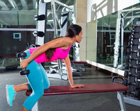 Dumbbell triceps kickback girl exercise at gym Royalty Free Stock Photography