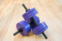 Dumbbell. Two blue big dumbbell on floor Royalty Free Stock Photo
