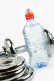 Dumbbell and water Royalty Free Stock Image