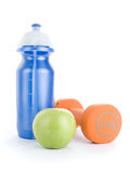 Dumbbell, water bottle and apple Stock Image
