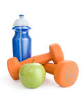 Dumbbell, water bottle and apple Royalty Free Stock Images