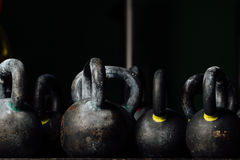 Dumbbell for weight training in gym. Black kettlebells.  24kg. Royalty Free Stock Photo