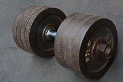 Dumbbell. Weight training to the strong muscle royalty free stock photography