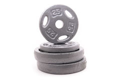 Dumbbell Weights Stacked on White Stock Image