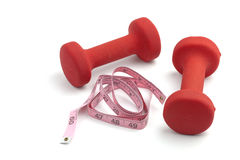 Dumbbell weights with tape measure Royalty Free Stock Photo