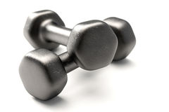Dumbbell on White. Dumbbell isolated over a white background royalty free stock photography