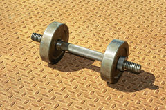 Dumbbell on a white background. Royalty Free Stock Photo