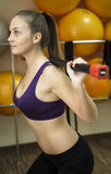Dumbbell woman weight workout in gym Stock Photography
