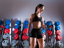 Dumbbell woman workout fitness at gym Stock Images