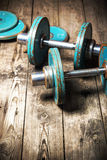 Dumbbell on the wooden floor Stock Photography