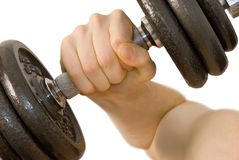 Dumbbell workout. Close-up of male arm lifting a heavy dumbbell stock photo