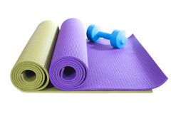 Dumbbell and yoga mats on white background royalty free stock photo