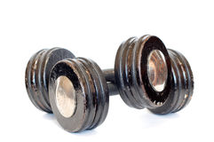 Dumbbells. Old dumbbells over a white background stock photo