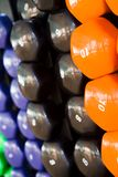 Dumbbells. Closeup in a fitness studio Royalty Free Stock Photography