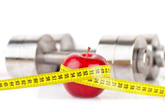 Dumbbells with an apple Royalty Free Stock Photo